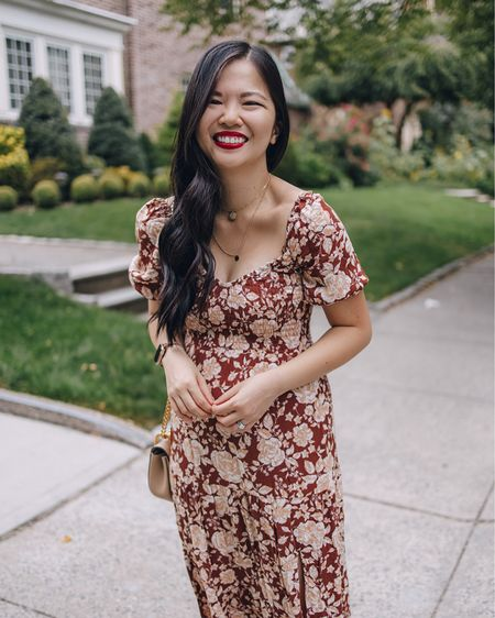 A floral dress to transition you from summer to fall. Love the puff sleeves and leg slit. Paired with a blush Chloe Drew bag and brown sandals.  Fall outfit, fall dress, wedding guest dress, Abercrombie, puff sleeve dress, burgundy dress, midi dress, petite dress.   #LTKunder100 #LTKstyletip #LTKwedding