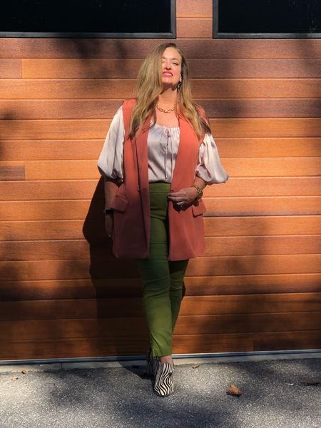 The Golden hour… wearing the trending green shade in slimming pants. Add a pumpkin ling sleeveless vest  and zebra booties and you have an easy updated Fall Look…   #LTKstyletip #LTKworkwear #LTKfamily