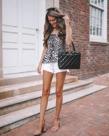 This Amazon top would look so cute with white jeans as the weather starts to cool down! 🍁 Amazon leopard tank, smocked tank, Amazon tank, Amazon finds, Amazon fashion, cmcoving, Caitlin Covington, white shorts, Chanel handbag, nude sandals, QUAY sunglasses, fall transition outfit, early fall outfit   #LTKSeasonal #LTKunder100 #LTKunder50