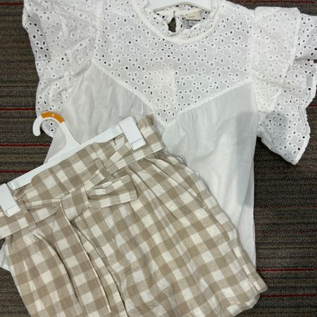 Perfect little shot outfit! And so affordable ✔️ . . This eyelet detail top is darling comes in for colors and great to wear with Jeans , shorts or a pencil skirt!  Bow shorts in gingham is just too cute! . Grab these summer staple pieces!  . .  You can instantly shop all of my looks by following me on the LIKEtoKNOW.it shopping app Follow me on the LIKEtoKNOW.it shopping app to get the product details for this look and others http://liketk.it/3hfhZ #liketkit @liketoknow.it #LTKunder50 #LTKstyletip #ltksummer #summershorts #summerstyle #summerfun #vacation #shorts #target #targethaul