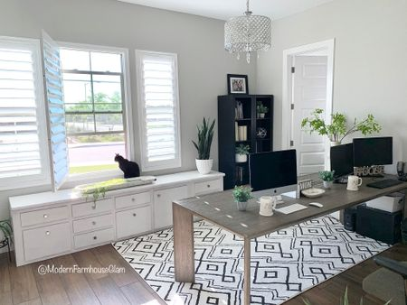 Our home office at Modern Farmhouse Glam. We used a large dining room table for our office table because it provides so much open space. Black and white rug, neutral area rug, storage, cabinets, office organization, cubbies, bookshelf, filing cabinet, crystal chandelier, lighting, office lighting, home decor, furniture, Wayfair, Amazon, Pottery Barn, Walmart home.    Shop my daily looks by following me on the LIKEtoKNOW.it shopping app http://liketk.it/3grVK #liketkit @liketoknow.it #LTKhome #LTKsalealert #LTKDay @liketoknow.it.home