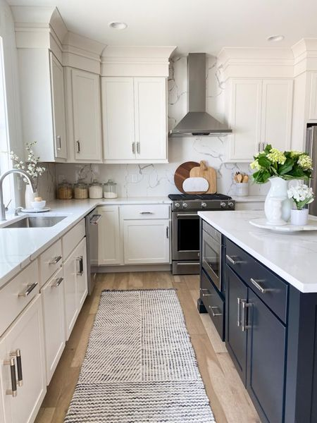 Custom kitchen design with studio McGee threshold from target. Hearth and Hand from target. Quartz countertops. Walmart glass containers. Knife set. Cutting boards. Pitchers, flowers, vases, picture frames, rug    #LTKhome #LTKunder100 #LTKSeasonal