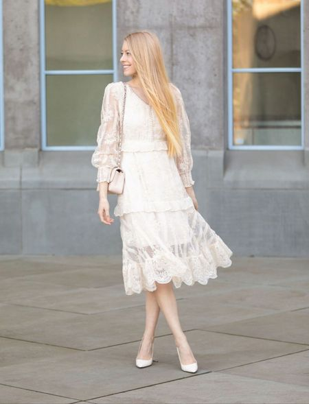 Spring summer lace dress midi length in white. Slightly puff sleeves and shoulders. Formal or great for church. Paired with white patent heels from Jimmy choo Dress from chicwish  #LTKunder100 #LTKSeasonal #LTKwedding