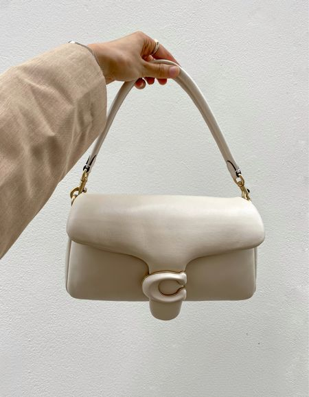 The IT bag of the season. How gorgeous is this Coach Tabby pillow shoulder bag. It will compliment all of your neutral outfits so well 🍂 The leather is so buttery soft and it also comes with a cross body strap.   For a limited time only, you can get 20% off any bag with my personal code: GEMMA20 when entered at the checkout online at MyBag.com   #LTKSeasonal #LTKitbag #LTKeurope