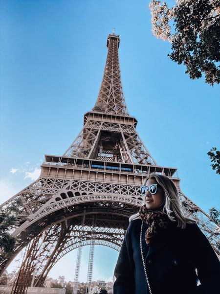 Black coat, faux leather leggings, leopard print scarf, Chanel boots, Chanel WOC, Celine sunglasses   #LTKtravel #LTKSeasonal #LTKstyletip