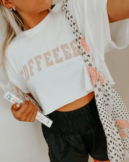 comf outfit | free people shorts, cropped white aerie top, a good book, and cute gold huggie hoops ✨ #LTKfit #LTKunder50 #LTKunder100 http://liketk.it/3jzxT #liketkit @liketoknow.it Shop your screenshot of this pic with the LIKEtoKNOW.it shopping app