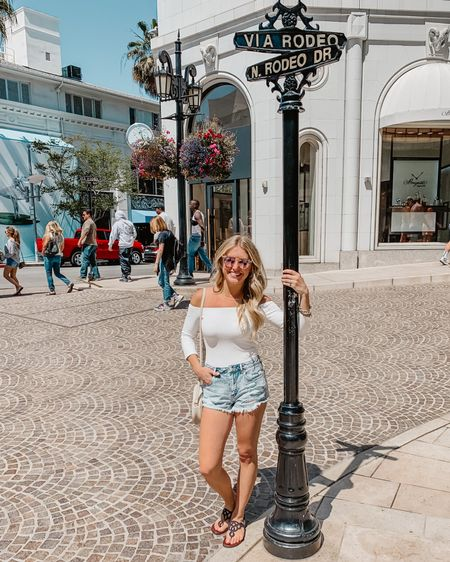 This white,  off the shoulder body suit  is on sale for UNDER $15!  Paired with the most comfortable distressed jeans shorts. David Yurman dupe bracelets & sandals! http://liketk.it/2NJZU @liketoknow.it #liketkit #LTKunder50 #LTKstyletip #LTKspring
