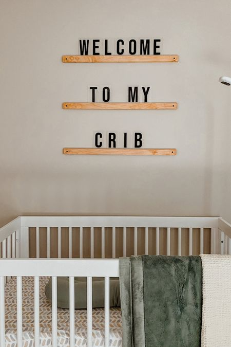 Love these Etsy wooden letter ledges in our gender neutral nursery! They would make a great baby shower gift or even Christmas gift for an expecting moms. Click to shop! 🤍 | baby room decor, nursery decor, nursery art, white crib, cozy baby blanket   #LTKhome #LTKstyletip #LTKbaby
