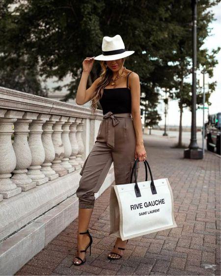 Summer vacation outfit Revolve jogger pants Nordstrom black bodysuit Saint Laurent Linen Tote  Nordstrom Panama Hat Tamara Mellon heels  http://liketk.it/3i0Ak #liketkit @liketoknow.it #LTKtravel #LTKstyletip #LTKunder100