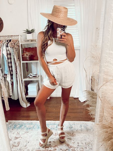 All white boho beach look 💕 Loving this wrap tie crop top and comfy boho shorts that also come in a really pretty sea foam blue color! I need them both 🙌🏻 Wearing a size small I'm both.   #LTKstyletip #LTKunder50 #LTKunder100