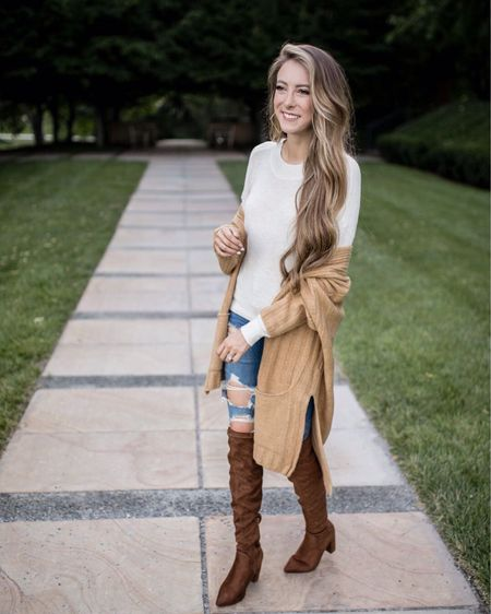 I'm OBSESSED with this fall transition outfit! A lot of it is from the #nsale Nordstrom Sale! I am wearing the long cardigan from top shop. It's a slouchy attitude, chunky ribbed texture and side vents for a relaxed swing fit. You'll want to live in this cardigan once the temps start to drop! I'm wearing this in a size small and in the color camel. I paired it with the most perfect lightweight sweater. The spider is in the color beige oatmeal light heather and I am wearing an extra small. It is from BP. Light weight yarn it makes its slouchy layer friendly sweater perfect for transitional weather. I'm wearing this with American Eagle outfitters super high waisted distressed jagging's. It goodnight macaroon 'Marlo 10 over the knee suede leather boots. It has a back zipper closure and it's artificial Suela in their upper and lining with the rubbler sole. It fits smaller to size. I am rocking my natural beaded row NBR hair extensions with a balayage! This is the perfect outfit for back to school whether you are starting high school or in college! I would totally recommend this for fall! Details: http://liketk.it/2EMMH   #liketkit @liketoknow.it   #LTKwedding #LTKswim #LTKsalealert #LTKbeauty #LTKbrasil #LTKeurope #LTKitbag #LTKshoecrush #LTKworkwear #LTKtravel #LTKunder50 #LTKspring #LTKkids #LTKunder100 #LTKstyletip  #beauty #onlineshopping #shop #streetstyle #boutique #beautiful #onlineboutique #photooftheday #fashionista #outfitoftheday #instafashion #handmade #sale #styleblogger #shoes #outfit #fashion #shopping #boutiqueshopping #style #love #art #autumn #beautiful #halloween #naturephotography #photographer #fashionblogger #christmas #nature #landscape #handmade #home #winter #photography #model #travel  #nordstrom #nsale  #nordstromanniversarysale #fallfashion #boots #ankleboots #shoegame #heels #fashion #shopsmall #winterfashion #liketkit #anklebooties #overthekneeboots #bootseason #love #fashionblogger #bootieseason #booties #style #bootsseason #winter #fashio