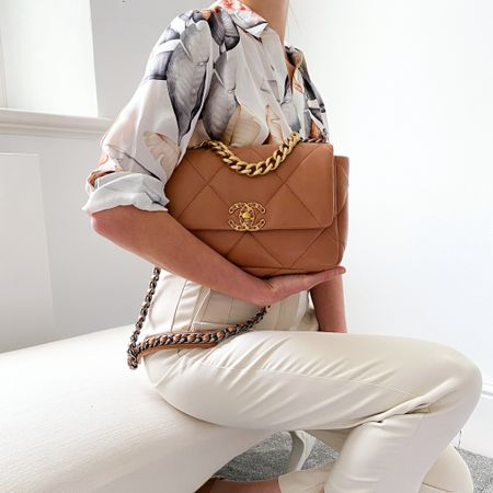 Small Chanel caramel 19 bag with cream trousers & printed Reiss shirt. This combination is one of my favourite outfits for this summer ✨  #chanel19 #chanelbag #summeroutfit #summerlook  #LTKSeasonal #LTKworkwear #LTKstyletip