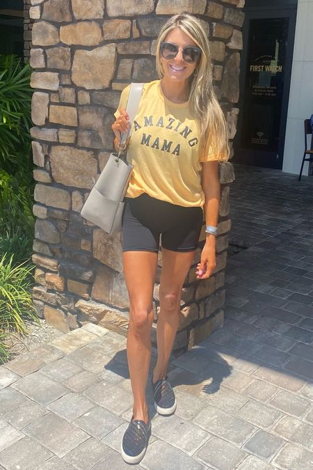 Love this mustard color Amazing Mama tee from Pink Lily. Paired it with my favorite black biker shorts. Wearing a size S in the tee and XS in the biker shorts. Oh and these are my new favorite Quay sunnies 😎