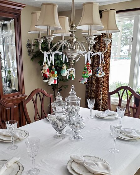 I love showing off our Radko ornaments by hanging them off the cha http://liketk.it/33wXt ndelier using some satin ribbon. Because they're do colorful, I kept the table simple, filling a trio of apothecary jars with silver, white and clear mini-ornaments and filler. No Christmas plates here, just our classic Lenox Federal Platinum set. A classic choice that I never regret. #liketkit @liketoknow.it #LTKgiftspo #LTKhome #LTKfamily @liketoknow.it.home
