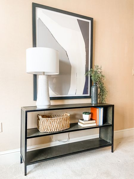 Low profile console table with large abstract art.  Console table, home decor, accent furniture, shelf style, black console  #LTKhome