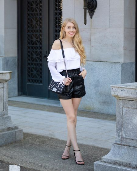 Black leather shorts White flowy off the shoulder top Black leather sandals mid heel Chanel small boy with pearls   http://liketk.it/3g0iY #liketkit @liketoknow.it   #LTKitbag #LTKstyletip #LTKshoecrush