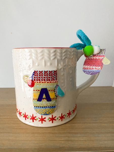 Holiday mug. Anthropologie. Christmas decor   Follow my shop @ashleyjennany on the @shop.LTK app to shop this post and get my exclusive app-only content!  #liketkit #LTKHoliday #LTKunder50 #LTKhome @shop.ltk http://liketk.it/3qcsh