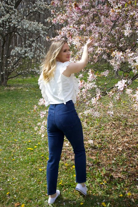 Spring outfit ideas. White eyelet top on sale for under $30 paired with dark jeans from Express and white canvas shoes   #LTKSeasonal #LTKsalealert #LTKstyletip