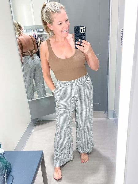 Love these blue striped wide leg beach pants with thjs brown crinkle one piece swim suit. Small pants and medium swimsuit. Target style beach vacation summer outfit ideas   #LTKSeasonal #LTKswim #LTKunder50