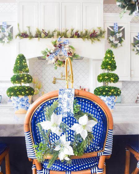 Chinoiserie Chic Christmas Kitchen ✨  . .  http://liketk.it/33E3G #liketkit @liketoknow.it #LTKhome #LTKunder50 @liketoknow.it.home Christmas decor, kitchen decor, white kitchen, holiday decor, blue and white, wreath, bar stool, kitchen design, Christmas ribbon, Christmas decorations, kitchen ideas, kitchen island
