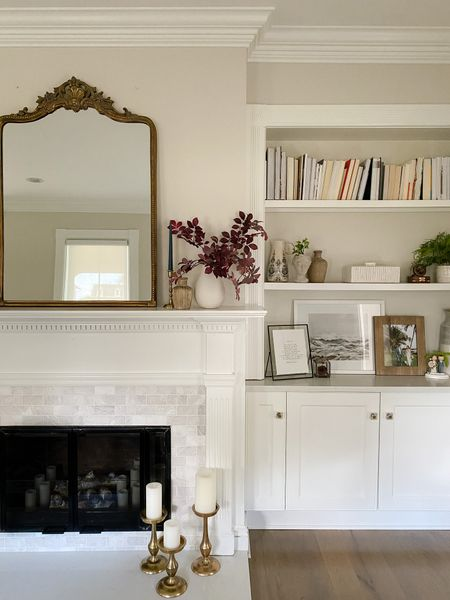"""Decided to rearrange our built-ins this morning and the change feels good! I removed everything from the shelves and had fun finding a new way to use them. Often you don't have to buy new things, just """"go shopping"""" from other parts of your home!     #LTKSeasonal #LTKstyletip #LTKhome"""