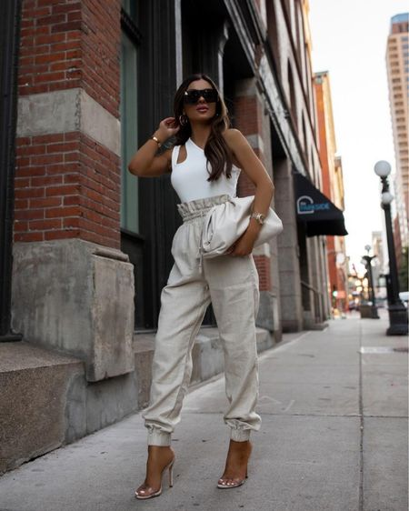 Nordstrom summer outfit  White cutout bodysuit wearing an XS Nordstrom linen pants wearing an XS Bottega Veneta The Pouch in Mist color  Schutz heels   http://liketk.it/3i6KE #liketkit @liketoknow.it   #LTKshoecrush #LTKunder100 #LTKstyletip