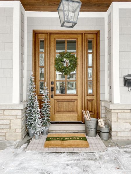 Christmas front door decor!! Linked the cutest little trees and doormats to make your front porch extra festive this year!!   #christmasdecor #frontporchdecor #wreath  #LTKhome #LTKHoliday