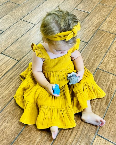 Absolutely in love with this sweet little golden yellow tiered dress complete with a matching headband. Snag this one up for your baby girl while you can. Runs true to size #LTKbaby #LTKkids #LTKunder50 @liketoknow.it #liketkit http://liketk.it/3izvc