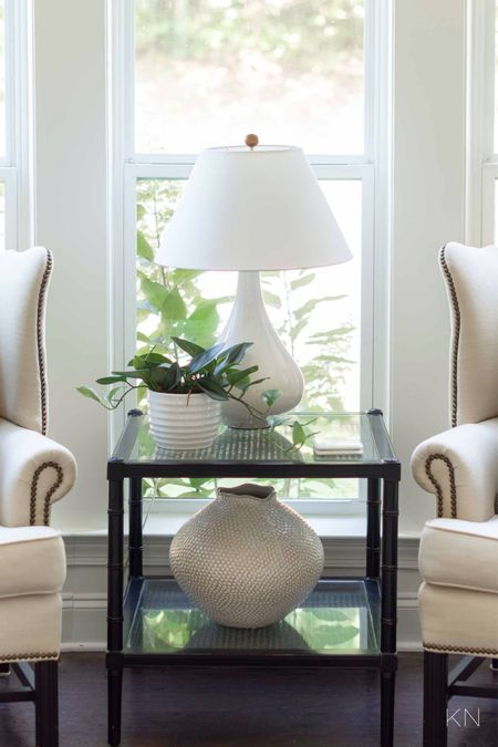 I'm keeping this moment simple for fall and only added a new lamp shade. Home decor living room decor wingback chair Eva vase fall decor  #LTKhome #LTKSeasonal #LTKstyletip