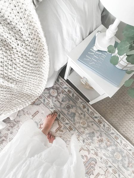Guest room design details. 🤍 Obsessed with this gorgeous vintage print rug and all of the light, bright and airy layers. #rug #duvetcover #bedsidetable #homedecor #vintagerug #guestroomdecor  #LTKhome #LTKunder100 #LTKunder50