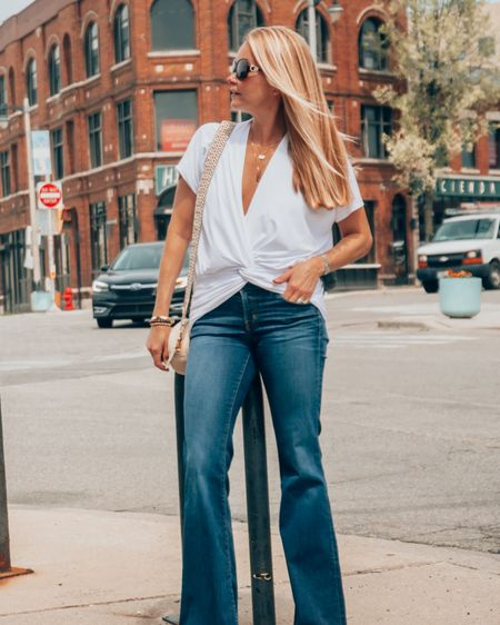 Quite possibly the best white top I have ever owned. Ruched bottom is so flattering. Deep v is perfect without  revealing it all. Available in black. Paired with flare jeans for a casual chic look. All fit TTS. #liketkit @liketoknow.it #LTKstyletip http://liketk.it/3ji7W Download the LIKEtoKNOW.it shopping app to shop this pic via screenshot.