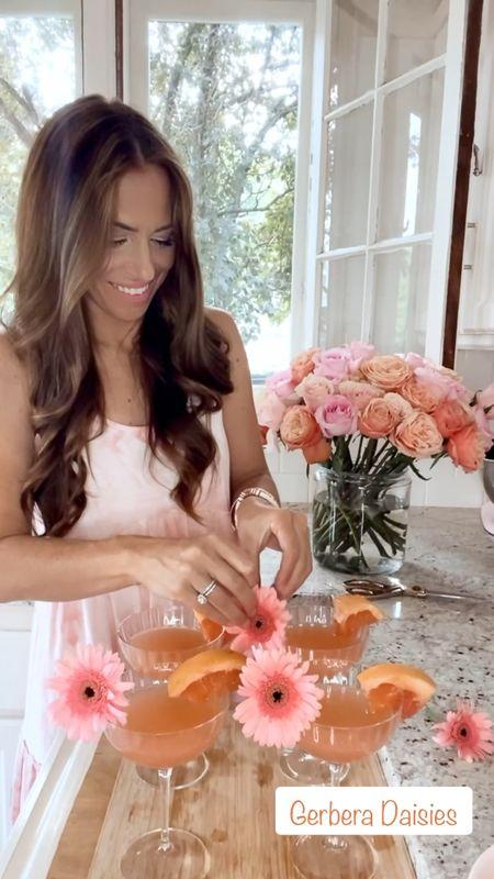 """Yeah we fancy like #FloralFriday on a date night .... 🌸   Boogie like a Grapefruit drink in a fancy glass... 🍹   Ingredients:  Pink Grapefruit Italian Soda  Grapefruit Slices  Gerbera Daisies (mini white clothespins)  Blood Orange Sorbet  Mint    #LTKhome #LTKunder100 #LTKunder50"