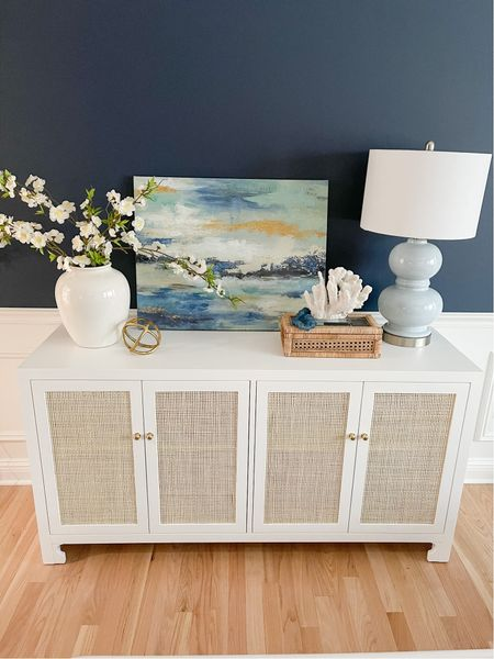 My dining room console is on sale for the lowest price I've ever seen it!   white console table, dining room console, white table, china cabinet, cane cabinet, Worlds Away cabinet   #LTKhome #LTKunder100 #LTKstyletip