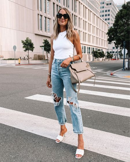 Love this white racer back tank (anine Bing / xs) linked bras that work with it! My favorite ripped AGOLDE jeans (size down). The perfect effortless summer outfit. Sandal dupes are from Amazon! #amazonfinds #amazonfashion #rippedjeans #summeroutfit http://liketk.it/3ijFI #liketkit @liketoknow.it #LTKstyletip #LTKunder100 #LTKunder50