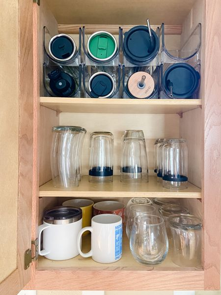 Kitchen organization! These water bottle organizers for the kitchen helped me quickly organize our cabinet of drinkware. Linking them at The Container Store!   #LTKhome