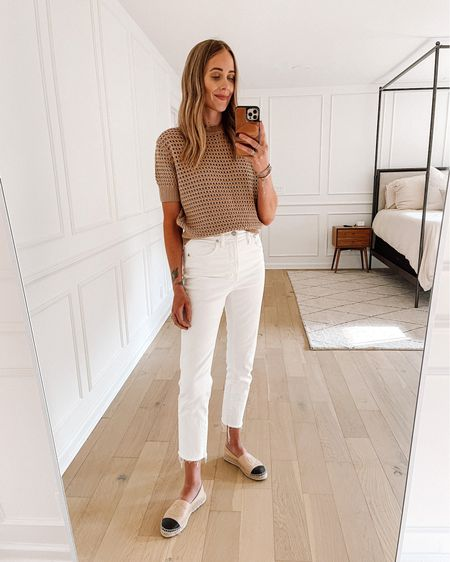 Daily outfit! Love this open knit sweater (xs / tts) just wearing a nude bralette and it's not see through at all! My favorite white jeans with stretch from madewell (size down) and Chanel espadrilles. Perfect late summer outfit   #LTKstyletip #LTKunder100 #LTKunder50