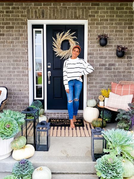 Here it is! The Fall porch update - Love it so much!  I started with the wreath (when I was pretending it was Fall) and now I've added accessories - all from @target! Loveeee the layered door mats, pillows, and faux plants that I added to my existing Target lanterns, planter and plant table.  Thank you @target for always giving us budget friendly home items to create a warm welcome.  Everything is linked in stories! Including this sweater which is also from @target, of course! #Ichoose#ad    #LTKSeasonal