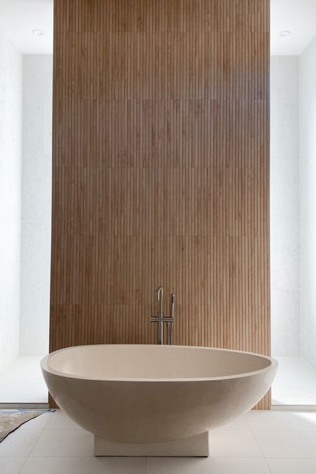 Stone freestanding tub. Concrete tub. Beige tub. Natural stone tub.   #LTKsalealert #LTKhome #LTKstyletip