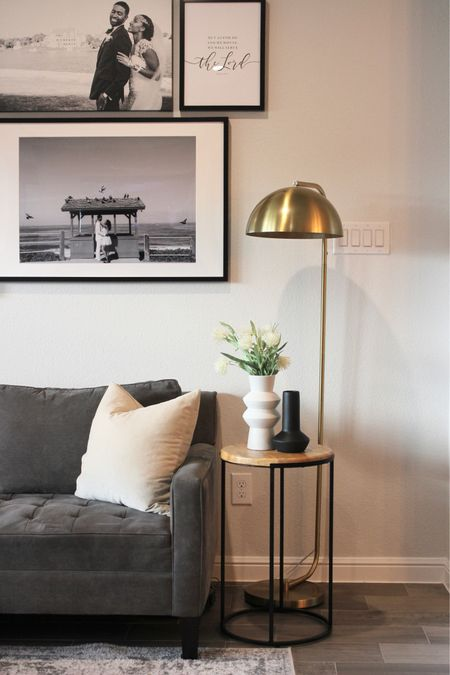 Modern living room decor. Brass floor lamp. Neutral decor. Modern end table. Black end table. Gallery wall. Gray sofa. Taupe throw pillows. Geometric vases. Spring modern. Vases sourced from Joann fabrics   #LTKstyletip #LTKhome