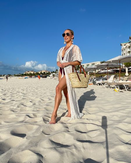 This Poolside raffia straw beach tote is the perfect size for both the beach, pool and as carry on and actually zips shut so everything doesn't fall out. Inside is removable bag that zips shut and snaps onto and off of the straw beach bag so you can wash it and get rid of any sand etc - Brilliant 👌🏻 Plus there's $25 off right now. PS my tans fake as I don't sunbathe it's all thanks to Tan Luxe dark face and body which is cruelty free and vegan. She'll earrings are Ettika, use code Eve20 for 20% off sitewide #wearwithconfidence  #LTKitbag #LTKbeauty #LTKswim