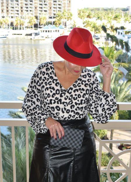 Amazon leopard, amazon leopard top, faux leather skirt, wool hat       #LTKstyletip