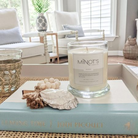 Added a few summer touches to my living room this week, including this affordable white rattan tray, oyster shell, vase and palms. I'm loving the casual, relaxed look of it all! This navy and white hand-painted vase is currently on clearance for under $40 so don't wait to scoop it up if you're interested in it! Minot's Candle Company candles can be purchased directly from their site.   @liketoknow.it @liketoknow.it.home #liketkit #LTKhome #LTKsalealert http://liketk.it/3gGFJ  spring decor, spring home decor, summer decor, summer decorations, summer home decorations, coastal decor, beach house decor, beach decor, beach style, coastal home, coastal home decor, coastal decorating, coastal house decor, blue and white decor, home accessories decor, coastal accessories, coastal living room decor, coastal family room, living room decor, white arm chair, spindle chair, neutral arm chair, serena & lily dupe, serena and lily dupe, arm chair, side chair, living room decor, living room ideas, neutral living room, neutral living rooms, neutral living room chairs, neutral home decor, cane, seagrass, rattan, coastal modern living room, rattan table, rattan table side, rattan side tables, side tables, wicker tables, living room side tables, bedroom tables side, bedroom side tables, water hyacinth tables, side tables Target, coffee table books blue, coffee table books coastal, blue and white coffee table books, drinking glasses set, woven glasses, raffia glasses, cane drinking glasses, cane glasses, napkin rings, oyster shell, lumbar pillows, lumbar throw pillow, lumbar pillows for chair, lumbar pillows for bedroom, pillows with poms, pillows with pom poms, navy and white pillows, striped pillows, striped pillow covers, amazon pillow covers, amazon pillows, white vase with palms, palm leaf, palm leaves, palm leaf stems, palm stems, stems in vase, stems home decor, blue and white home, blue and white house, blue and white vases, pottery barn vases, target decor, target home, ceramic 