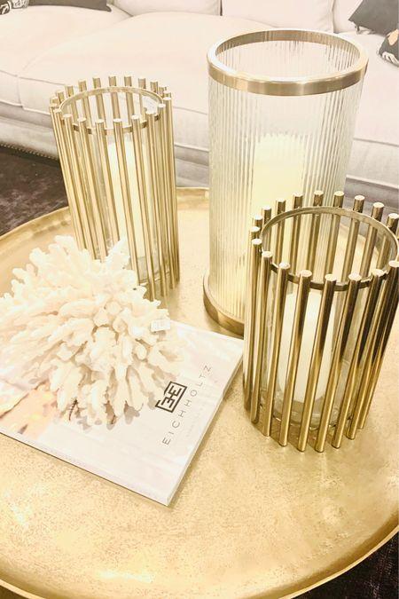 http://liketk.it/3gNNX #liketkit @liketoknow.it @liketoknow.it.home #LTKhome  Gold glass hurricanes  Coral decor  Gold round tray  Pillar candles