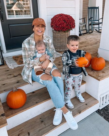 """Picked out our pumpkins to carve tonight! 👻 Swipe to see how they turned out. 👉🏼 Are you carving pumpkins this year? I haven't done it in years, and Tom & I went to town on these after the boys went to bed, and Keldon had fun playing with the """"pumpky guts"""" earlier. 🥰 Outfit linked in my bio! #happyhalloween #keldonthomas #fritzhudson #iloveoctober #fallthings   #LTKfamily #LTKSeasonal #LTKunder100"""