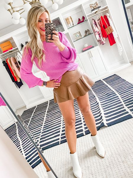 15% off with LAUREN15. Wearing a small sweater and a medium skort.