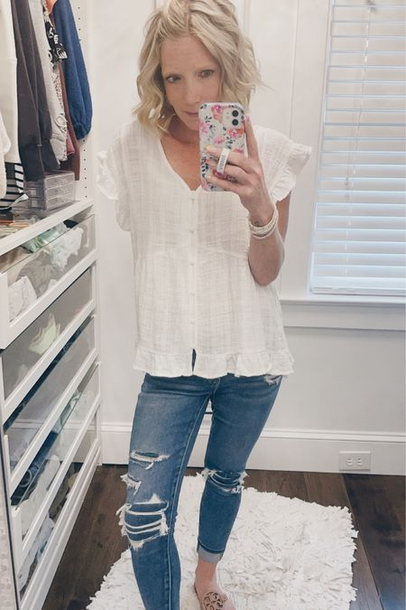 Another day, another white top and denim 😂🤷♀️.  Love this peasant style too that is on sale at Boutique On Thirty and these patched denim jeans from American Eagle. You can instantly shop my looks by following me on the LIKEtoKNOW.it shopping app http://liketk.it/3hyh4 #liketkit @liketoknow.it @boutiqueonthirty @americaneagle