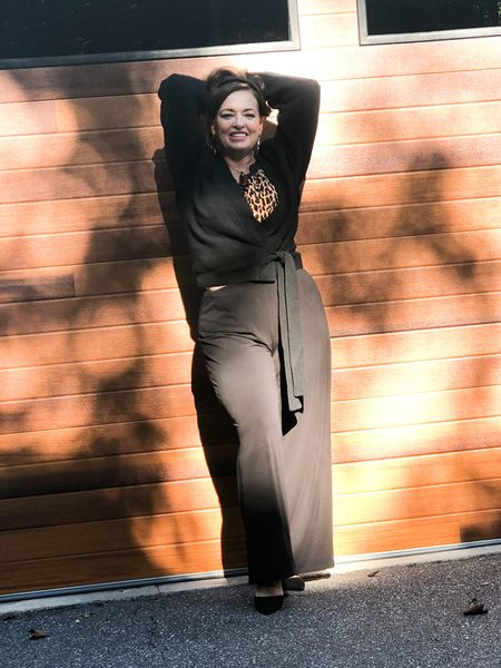 I have been looking forward to wearing this exquisite black cashmere wrap sweater. It feels so luxe on .   #investmentpiece  Timeless style   Perfect for work, date night and travel! I love it paired with my easy black travel pants and leopard camisole!   #LTKGiftGuide #LTKtravel #LTKstyletip