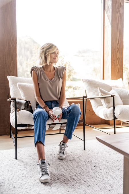 Loverly Grey has paired this soft v-neck tank with a distressed denim and a sneaker.  #LTKstyletip