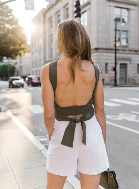 The best open back top in my closet 🙌🏻 Linked more summer tops with fun back detail or halter style straps as well!   open back top, tank tops, tank top, summer top, white shorts, dressy shorts  #openbacktop #cutesummeroutfits #knittanktop #summertops #dressyshorts   #LTKstyletip #LTKSeasonal http://liketk.it/3hyFY #liketkit @liketoknow.it