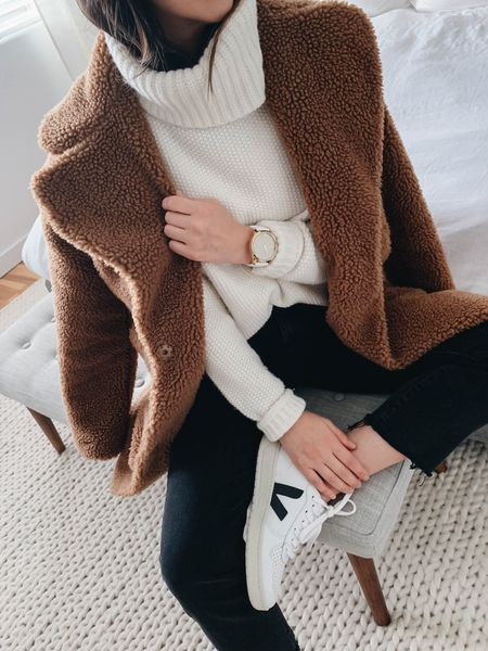 Abercrombie & Fitch teddy coat. Wearing the xs. Fits petites well. Mine is darker from a few years ago.